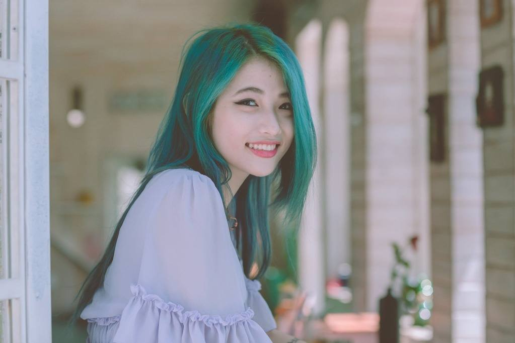 woman with a beautiful blue green hair