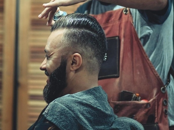 man having a hair cut